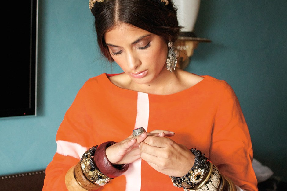Model Samira Mahboub tests an oversized ring, one of over 100 handcrafted jewelry pieces selected from Jaipur's Amrapali jewelers for our shoot