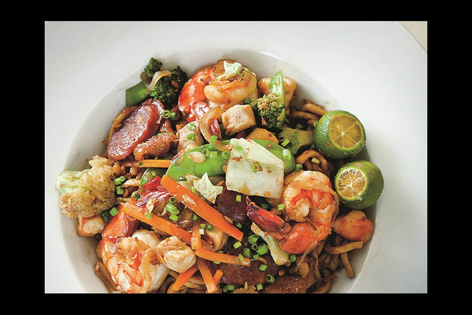 COLORFUL PANCIT GUISADO IS A CHINESE-INSPIRED DISH OF PRAWNS, PORK BELLY AND CHICKEN OVER EGG NOODLES
