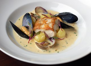 Roast Powell River Sturgeon Chowder with Manilla Clams, Island Mussels, Fondant Potato, Fennel and T