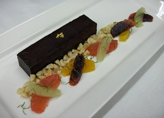Chocolate Tart with Citrus Salad and Crushed Hazelnuts
