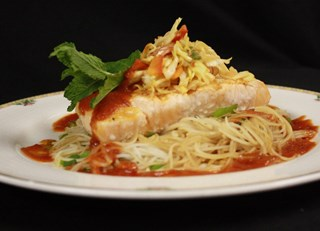 Grilled salmon, rice noodles, Asian slaw, tomato jus