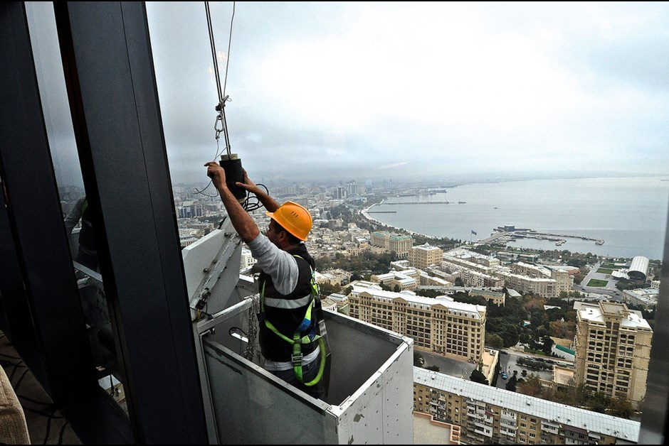 Cleaning the windows on the 19th floor