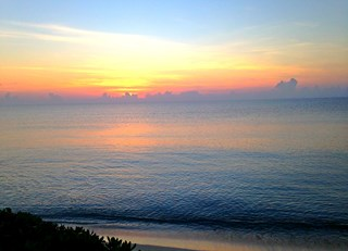 A beautiful sunrise by the beach @FairmontMYK!