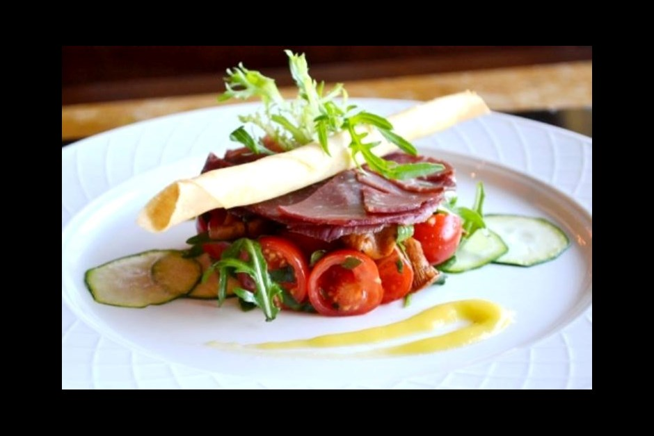 Chanterelle bresaola salad with cherry tomatoes