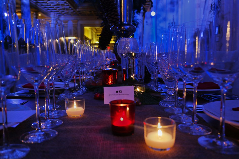 Farm tables were lined with festive, holiday decor and twinkling candles