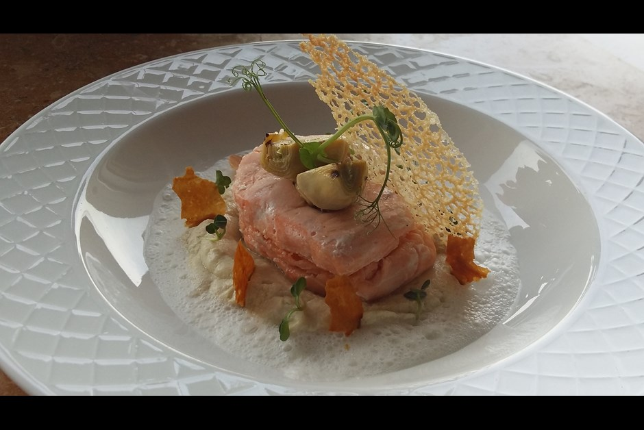 Salmon medallion with truffle on a artichokes velouté with foamed parmesan milk