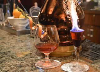 Pomniac with a Flaming Cassis Shot