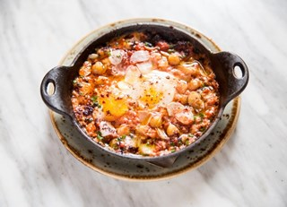 Chickpea Shakshuka with Farm Fresh Eggs, Aleppo Chili and Zugh