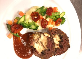 Mini meatloaf stuffed with cheese curds, homemade plum and apricot BBQ sauce