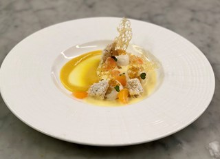 USA TODAY includes Chef David Blom's Oeufs a la Neige dessert in their Winter Sweets Round-Up